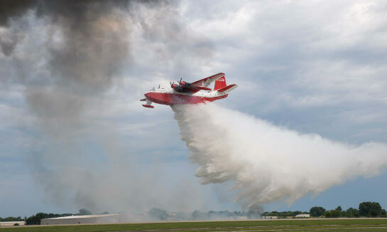 The Hawaii Mars was attending Oshkosh for the first time; in past years, the aircraft has been busy fighting wildfires. Now, the massive flying boat is for sale along with its sister ship, Philippine Mars. Warren Liebmann Photo