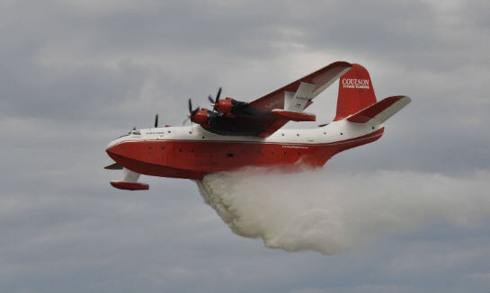 Hawaii Mars executes a water drop over a simulated wildfire in front of a crowd of enthusiastic spectators at EAA AirVenture Oshkosh 2016. Kenneth I. Swartz Photo