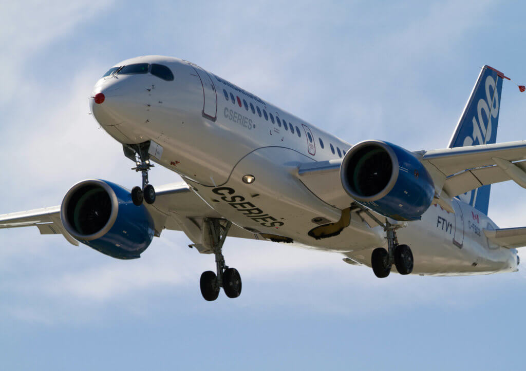 Bombardier CS100 airplane in flight