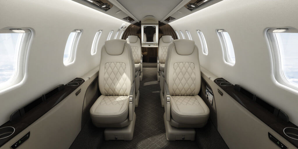 The interior of the Lear 75 features a double club seating arrangement with a 4'11