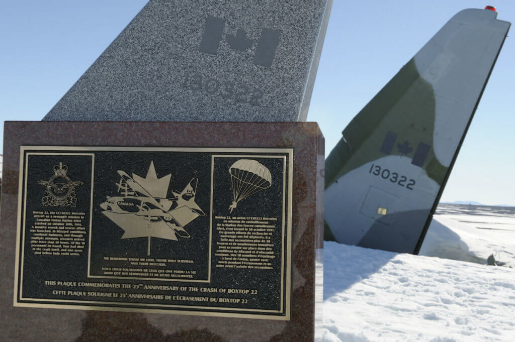The cairn commemorating the crash rests just metres from the tail of CC-130 Hercules 322.