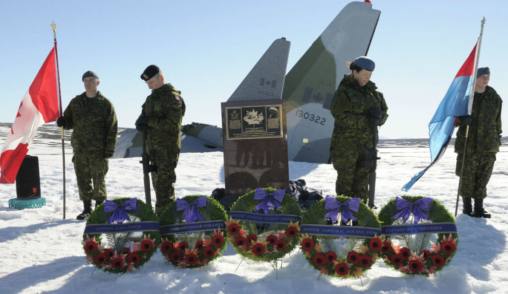 Cpl Brett Guitard (left), LS Garnet Robinson, Cpl Yvette Cedeno and Avr Alain Fortier serve as sentries at the memorial cairn during its dedication marking the 25th anniversary of the crash of Operation Boxtop Flight 22