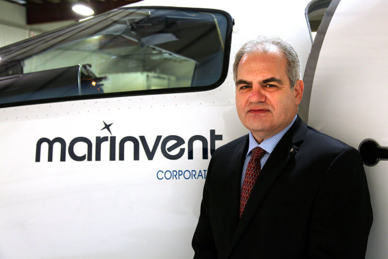 John Maris stands in front of a Marinvent plane.