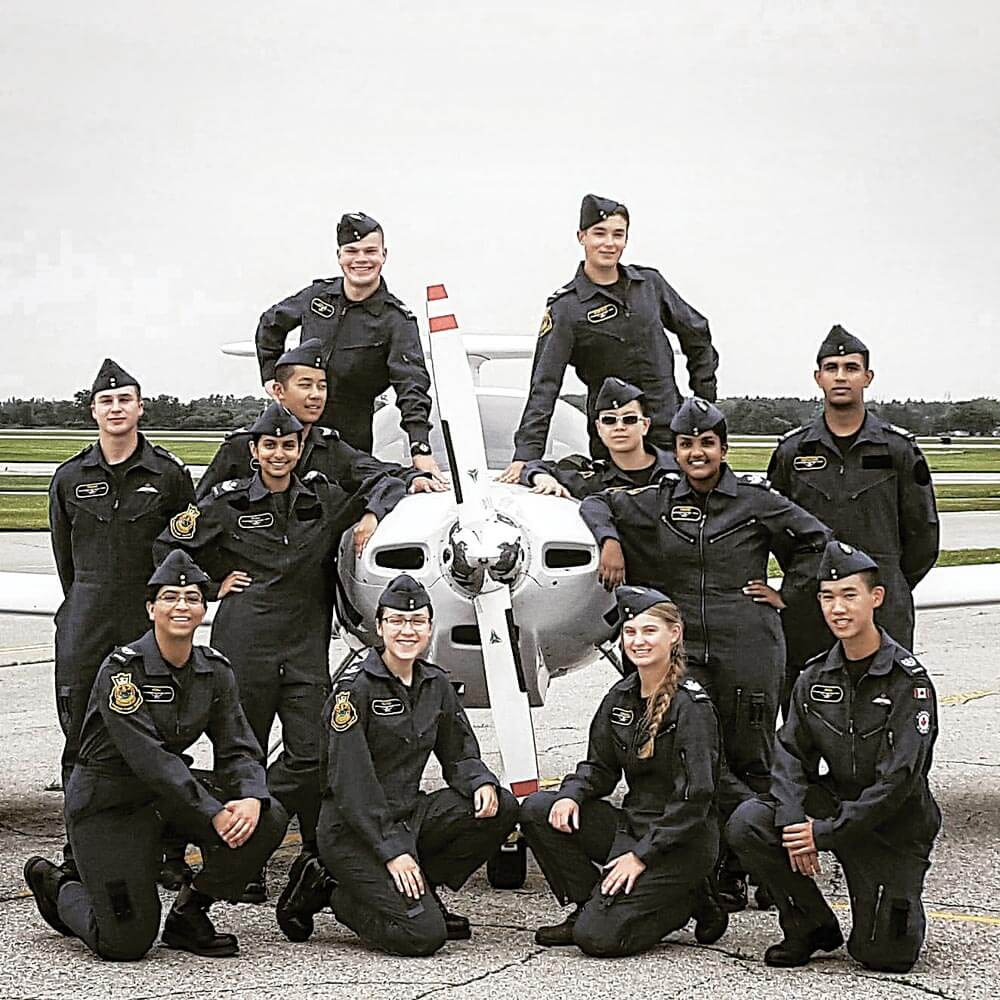 Powered flying course graduates pose with a DA-20 Katana at the Diamond Flight Centre in London, Ont. Photo courtesy Arik Collins