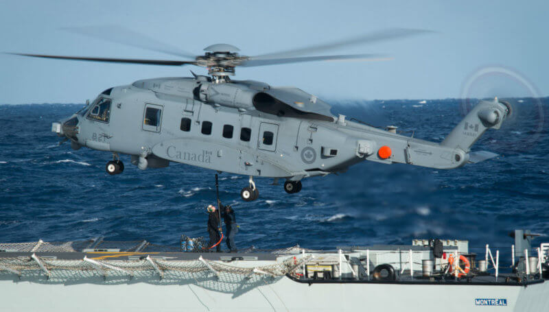Crew members onboard Her Majesty's Canadian Ship (HMCS) ***Montreal*** conduct vertical replenishment training with the CH-148 Cyclone helicopter during Exercise Spartan Warrior 16 in the Atlantic Ocean on Oct. 31, 2016. MCpl Jennifer Kusche Photo