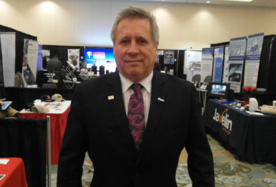 Air Transport Association of Canada president John McKenna walks the tradeshow floor at the organization's annual conference in Vancouver, B.C. This year, 52 companies exhibited products and services geared toward the air transport industry. Lisa Gordon Photo
