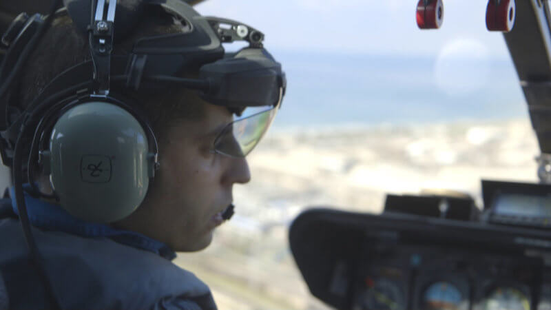 Pilot wearing Skylens system in cockpit
