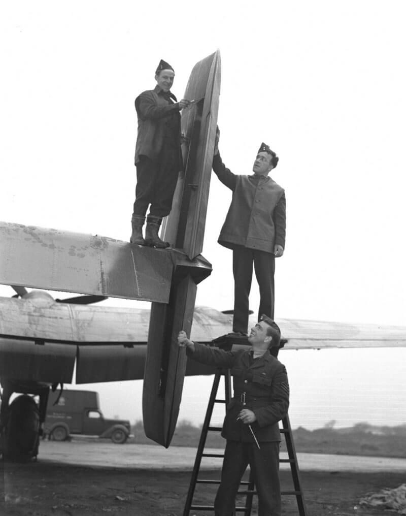 "This undated photo shows groundcrew of 428 ""Ghost"" Squadron working on one of ""their"" aircraft. DND Photo"