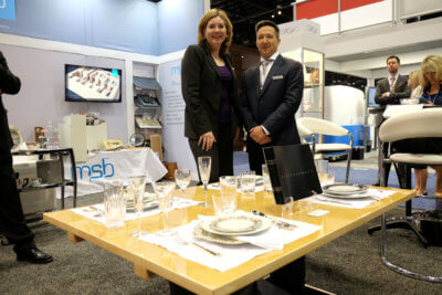 Shannon Gill, director of business development for MSB Design, stands with Mario Sévigny, the company's vice-president, next to one of the company's new tables. Ben Forrest Photo