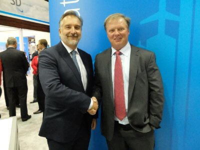 Jim Jensen, founder and CEO of Satcom Direct, right, shakes hands with Mark van Berkel, president and CEO of TrueNorth Avionics, at NBAA 2016. During the show, it was announced that Ottawa-based TrueNorth would be acquired by Satcom Direct. Lisa Gordon Photo
