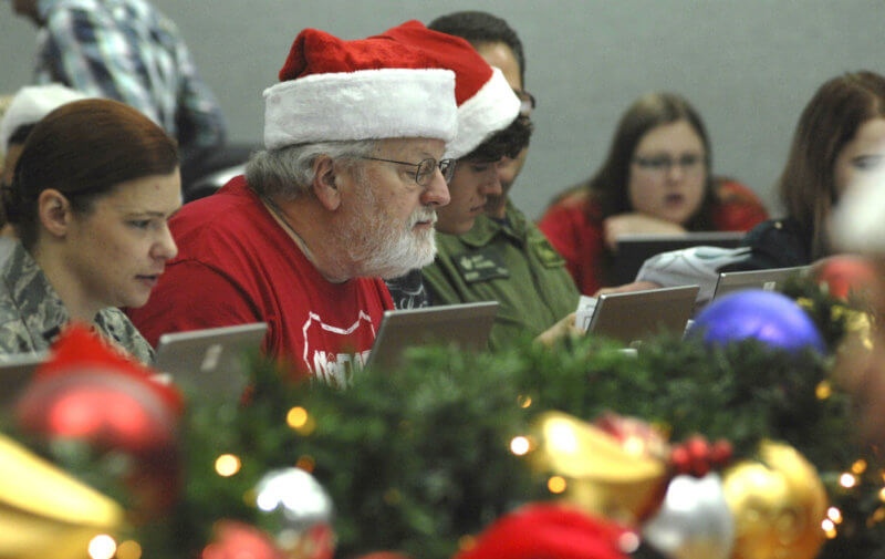 About 1,500 volunteers contribute to NORAD Tracks Santa, with many serving as operators who answer calls from children about Santa's whereabouts on New Year's Eve. NORAD Photo