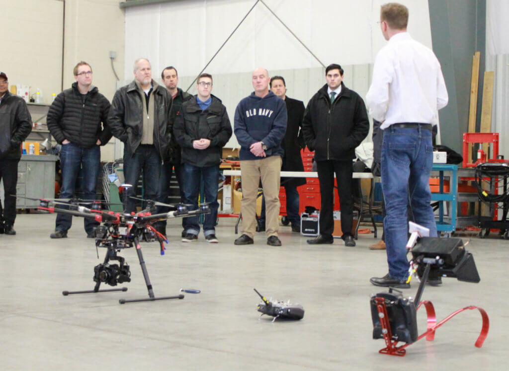 Students in the UAV pilot training course at Waterloo Wellington Flight Centre gather in the hangar for some practical flying experience. WWFC Photo