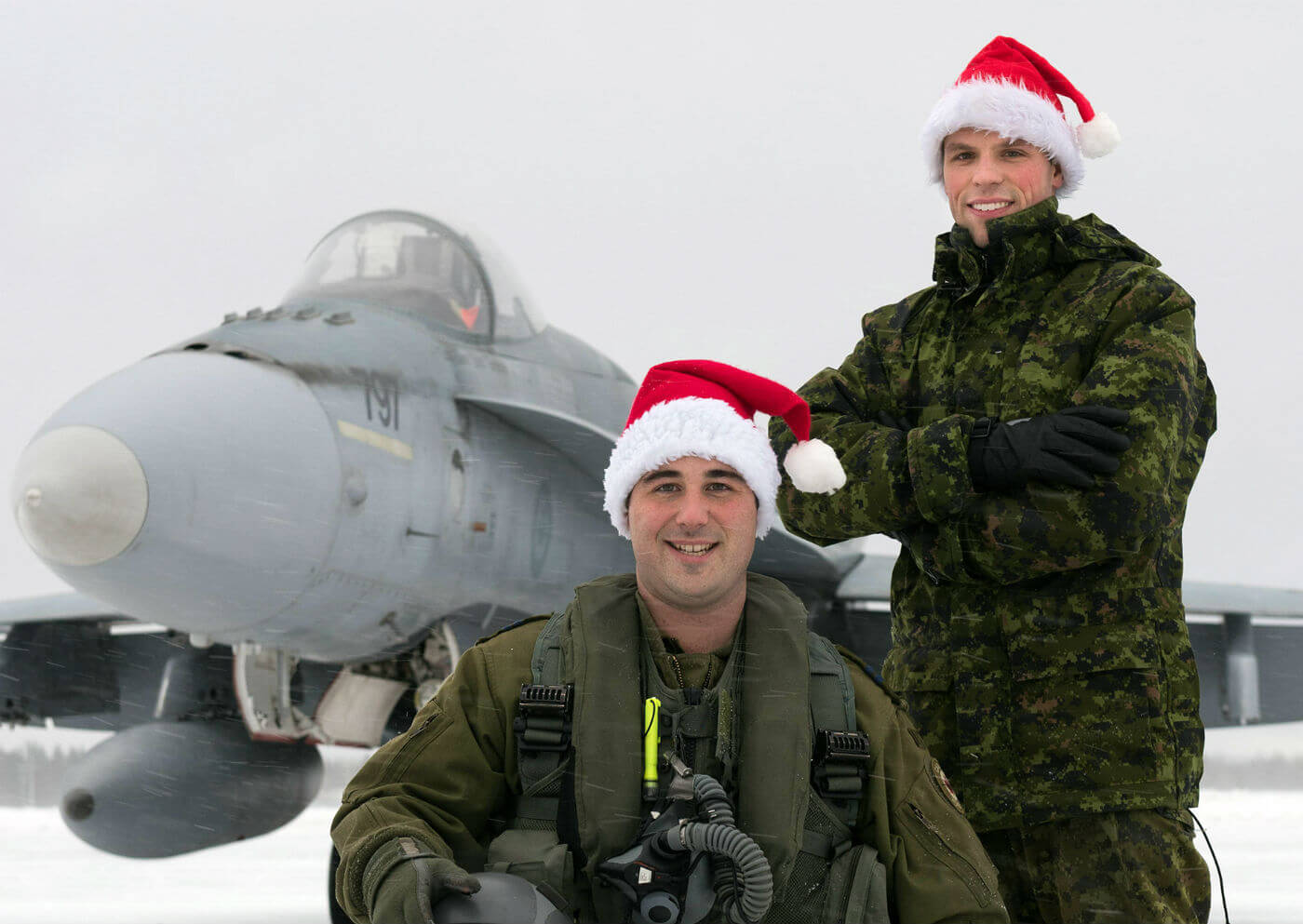 Capt Frédéric Létourneau (kneeling) from 425 Tactical Fighter Squadron at 3 Wing Bagotville, Que., is one of the pilots who will escort Santa over North America in 2016. Cpl Steeven Cantin is his crew chief. Cpl Jean-Roch Chabot Photo