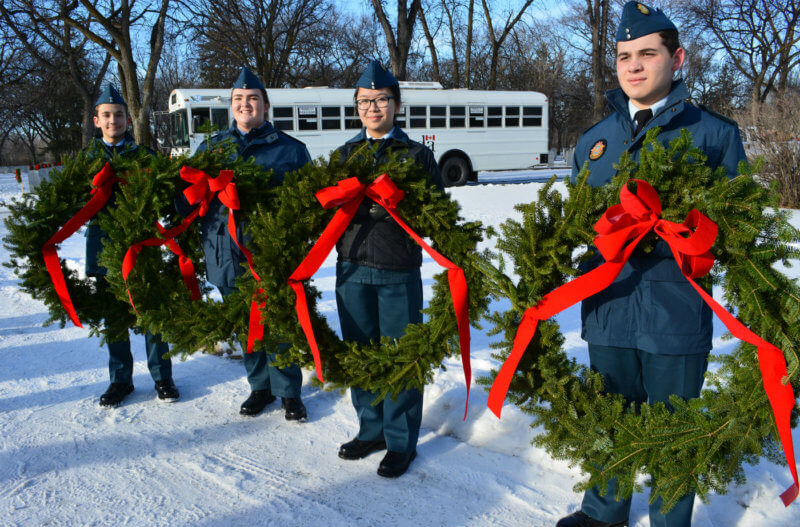 Volunteers from the Canadian Armed Forces, Canadian Cadet Organizations, the Knights of Columbus and the City of Winnipeg, as well as local businesses took part in and supported Winnipeg's second Wreaths Across Canada event in early December 2015. Here, Royal Canadian Air Cadets wait to lay wreaths at the graves of Canadian Armed Forces personnel in Brookside Cemetery's Field of Honour. DND Photo