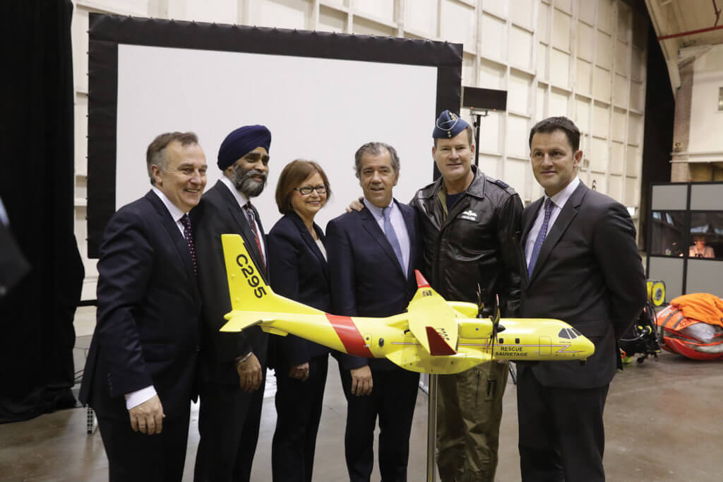 Representatives from the RCAF, the Canadian government and Airbus Defence and Space gather behind a model of the Airbus C295W at CFB Trenton on Dec. 8, 2016. Warren Liebmann Photo