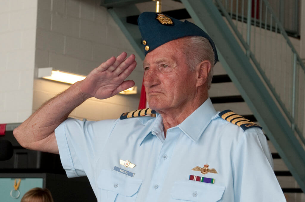 Honorary Col Fred Moffitt salutes during a ceremony at 9 Wing Gander, N.L., in July 2014.