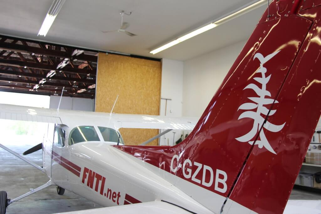 The school's Cessna 172 Skyhawk rests in a hangar