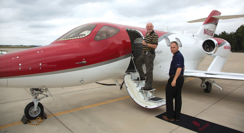 The author climbing aboard the HondaJet with test pilot Stefan Johansson.