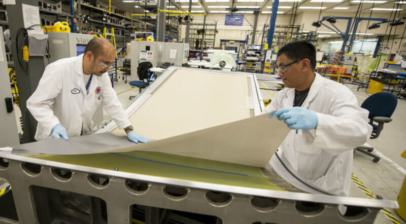 Staff at Boeing Winnipeg prepare for the fiberglass layup process. The company was asked to provide a detailed outline of the industrial and technological benefits Canada could expect in association with an interim Super Hornet fighter jet purchase. Bob Ferguson Photo