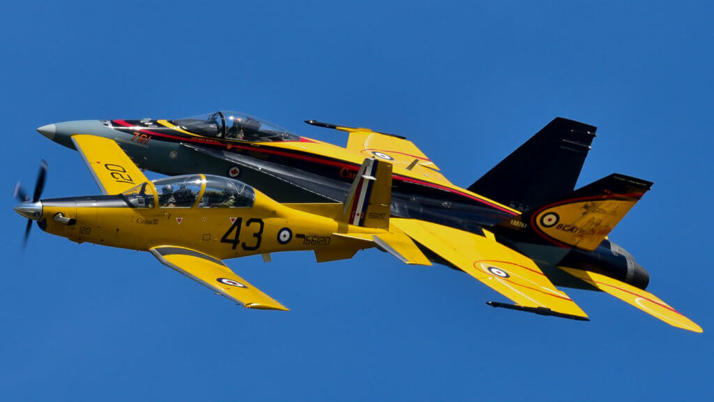 The 2016 CF-18 Demo Hornet and a specially-painted CT-156 Harvard II in wartime markings perform a commemorative flight in honour of the British Commonwealth Air Training Plan. The BCATP was a massive Second World War aircrew training effort, set in Canada, that was responsible for training 131,553 Allied aircrew. Today, the CT-156 is used by the RCAF for fighter lead-in training. Mike Reyno Photo