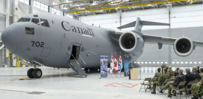Liberal Member of Parliament Karen McCrimmon marks the opening of the newly-constructed Hangar 6 at 8 Wing Trenton on Jan. 25, 2017. In the background is a CC-177 Globemaster strategic transport aircraft. DND/CAF Photo