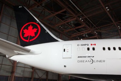 Photo captures the tail of the Air Canada Dreamliner, with new livery.