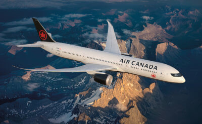 Air Canada airliner in flight, with new livery
