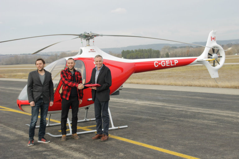 Mischa and Sancho Gelb, owners of British Columbia-based BC Helicopters, stand with Bruno Guimbal, president and CEO of Hélicoptères Guimbal.