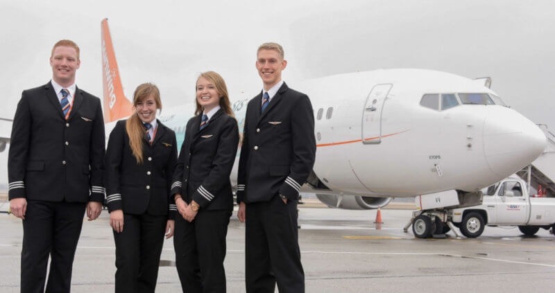 From left to right are newly-minted Sunwing First Officers Cameron Fuchs, Chelsea Anne Edwards, Siobhan O'Hanlon and Spencer Leckie on the ramp at the Regional of Waterloo International Airport. Mike Reyno Photo