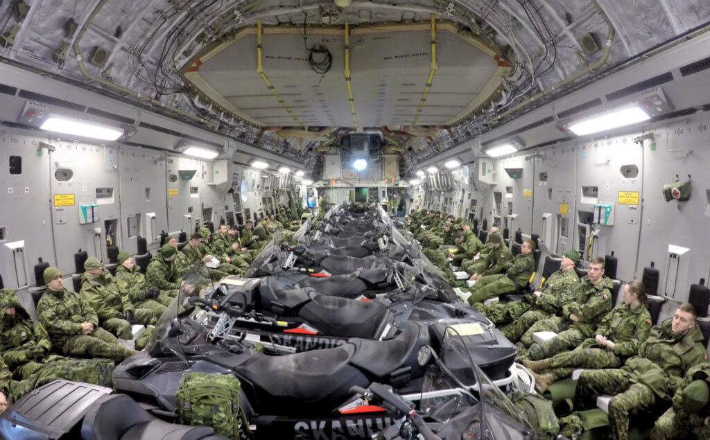 Deployed members of 12e Régiment blindé du Canada (12 RBC) travel from Canadian Forces Base Valcartier to Hall Beach, Nunavut on a CC-177 Globemaster, on Feb. 21, 2017. National Defence Photo
