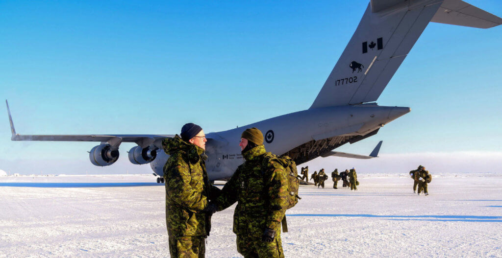 Maj Pierre Maillet, Joint Task Force (North) Detachment Nunavut Commander, welcomes LCol Eric Landry, Task Force NUNALIVUT Commanding Officer upon arrival at Hall Beach, Nunavut, on Feb. 23, 2017. National Defence Photo