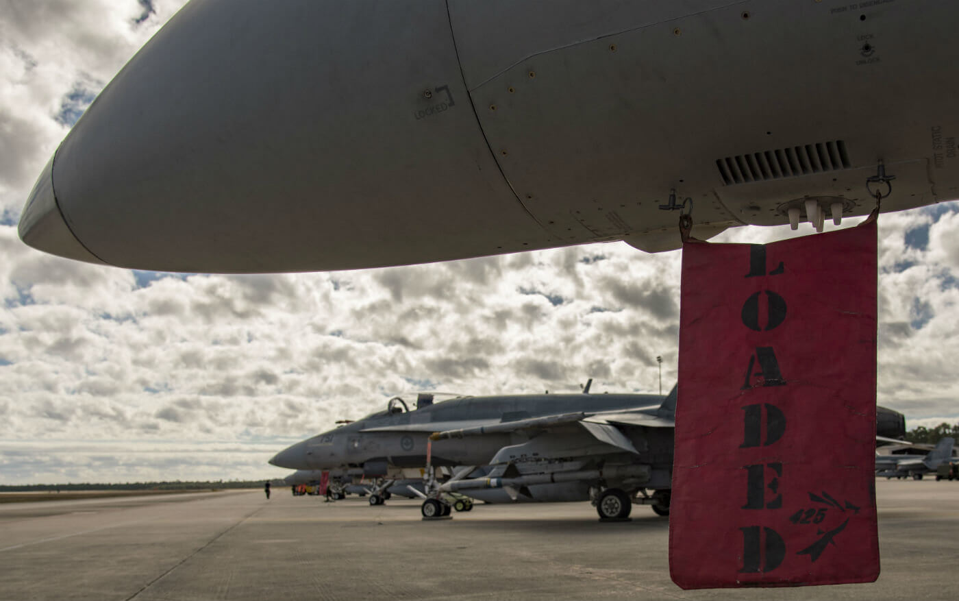 "A ""loaded"" flag hangs from a CF-188 Hornet fighter on Feb. 1, 2017, during Exercises Combat Archer and Combat Hammer, held at Tyndall Air Force Base, Fla. Cpl Bryan Carter Photo"