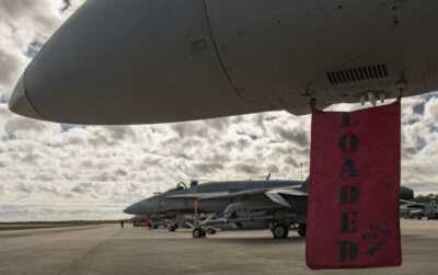 """A """"loaded"""" flag hangs from a CF-188 Hornet fighter on Feb. 1, 2017, during Exercises Combat Archer and Combat Hammer, held at Tyndall Air Force Base, Fla. Cpl Bryan Carter Photo"""