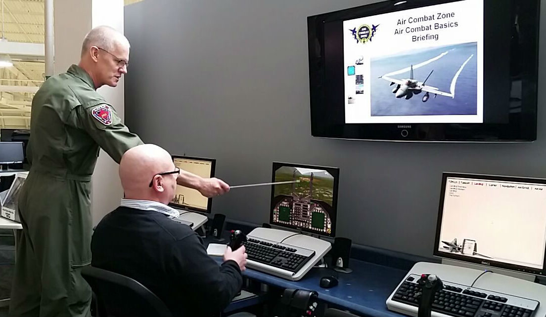 Before climbing into the cockpit, each person is given 20 minutes of training on the PC simulators, which teaches them how to fly the simulator, how to use the radar and the weapon systems, and goes through a quick briefing on threat indicators and using flares. Locked On Photography Photo