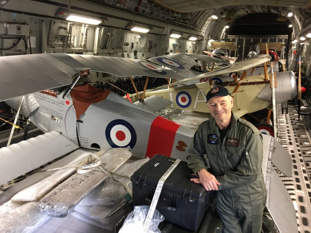 Allan Snowie, team lead for Vimy Flight, stands with several replica aircraft inside the CC-177 Globemaster.
