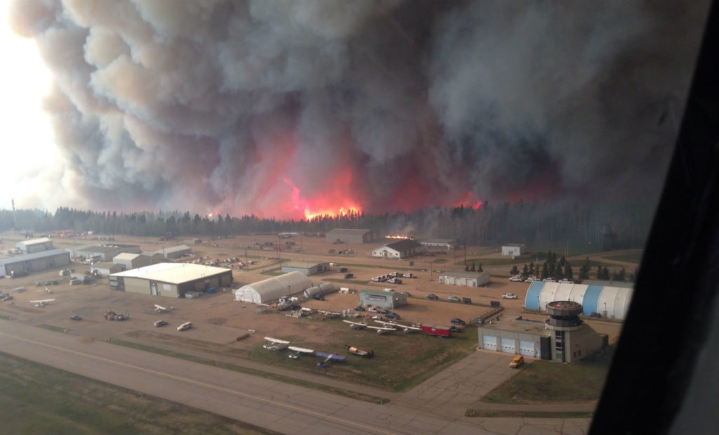 Commercial operations were suspended at Fort McMurray International Airport on May 4, after wildfires neared Airport Road south of the municipality. Wood Buffalo Helicopters Photo