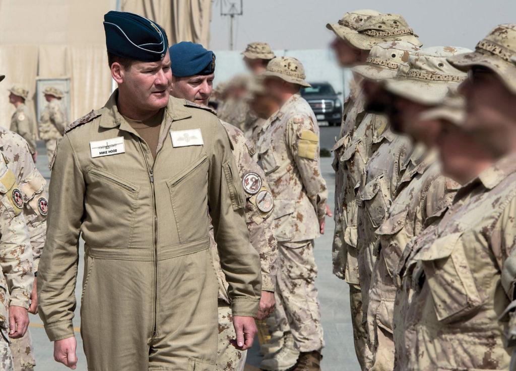 LGen Mike Hood inspects troops.