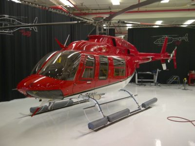 Bell 407GXP helicopter resting inside building