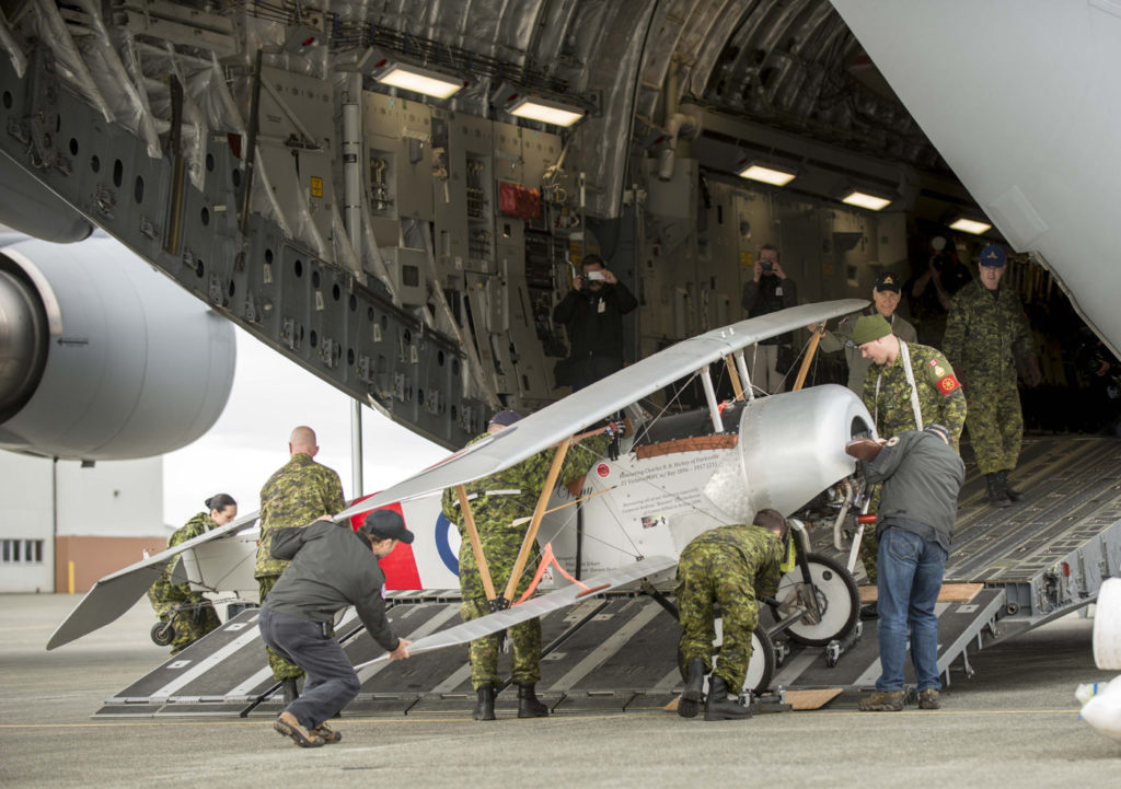 A Nieuport XI replica is loaded into a CC-177 Globemaster at 19 Wing Comox, B.C., before being transported to France.