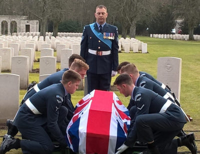 Members of the Royal Air Force Queen's Colour Squadron place Sgt Wilfred Lawson's coffin on the gravesite in the Berlin 1939-1945 War Cemetery in Germany. Crown copyright, United Kingdom Photo