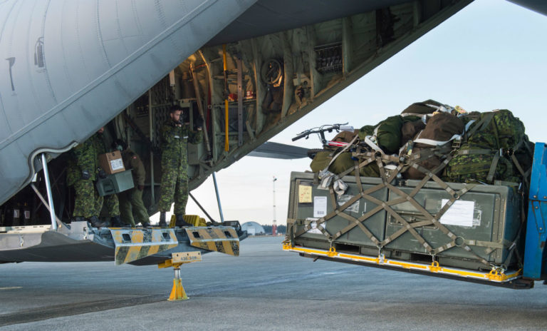Personnel from 2 Wing Bagotville, Que., unload the equipment required to set up a camp and air operation centre tailored for humanitarian disaster assistance relief missions during Exercise Ready Renaissance. Sgt Halina Folfas Photo