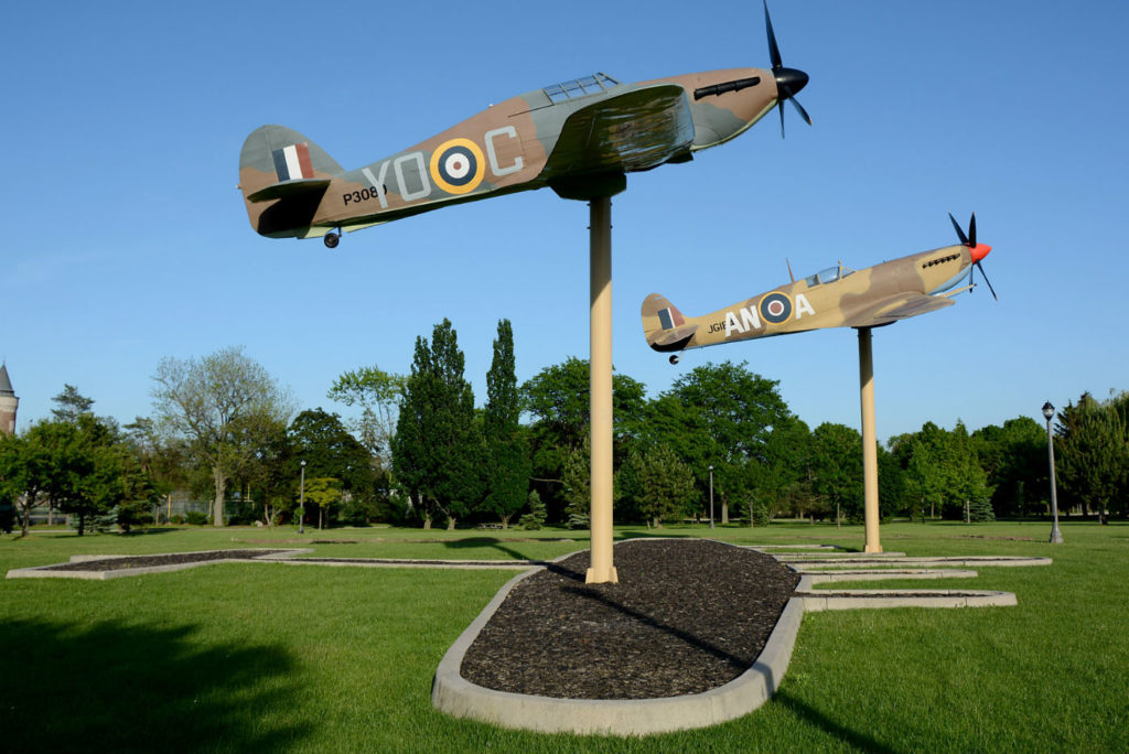 Fiberglass replica Spitfire and Hurricane fighters displayed at Windsor's Jackson Park.