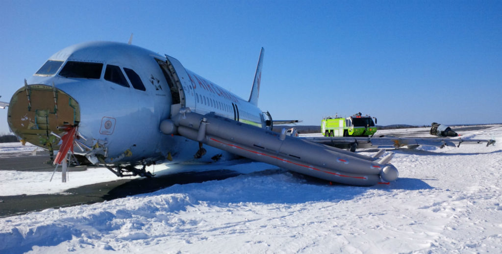 The aircraft--with 138 people on board including crewmembers--impacted the snow-covered ground about 740 feet before the runway threshold before bouncing on the ground twice more and then skidding to a stop on the runway. TSB Photo