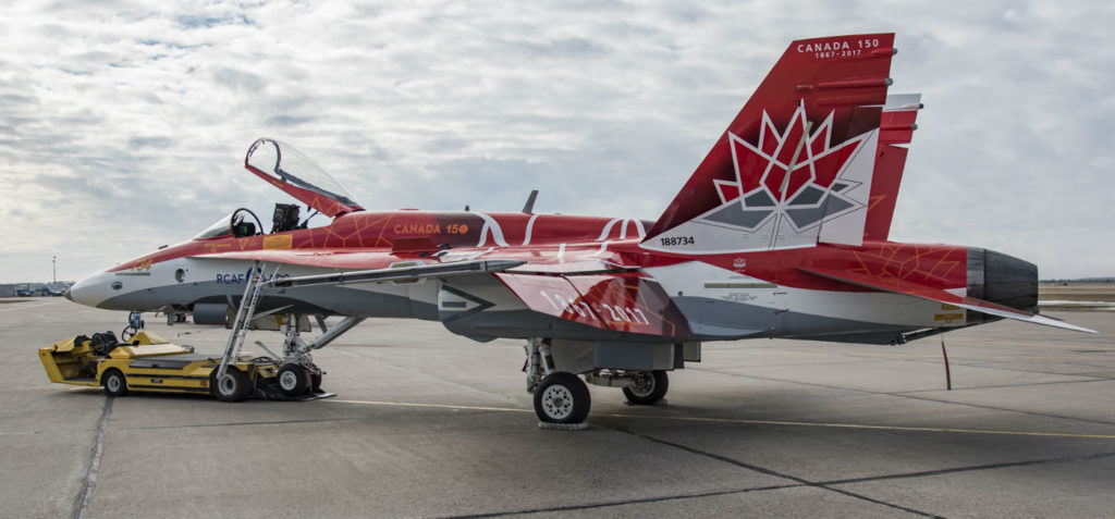 The CF-18 Demonstration Jet's paint scheme has the aircraft fully-painted with a red and white design incorporating the Canada 150 logo. DND Photo