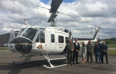 "Developed as a cost-effective means of enhancing the performance of the enduring UH-1H platform, the UH-1H3 ""hot, high, heavy"" upgrade offers operators a portfolio of technical solutions with which to customize the Huey to their specific requirements. Pictured here: Capt Jeff Rose and Lt Al Daniel of the SBCSD and the Vector team in Langley, British Columbia. Vector Photo"