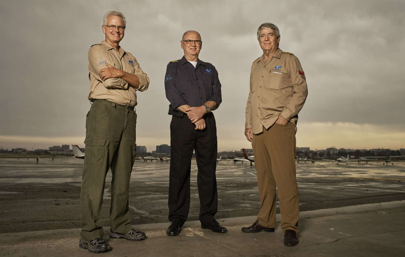 Pilot Russ Airey, left, stands with his co-pilot Harold Fast and fellow pilot Dave McElroy at an airfield in Ontario. The three plan to circumnavigate Central and South America next year to raise money for Hope Air. Stephen Caissie Photo