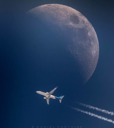 An Air Transat airliner flies over Austin, Que., with the moon as a backdrop. Photo submitted by Daniel Fontaine.