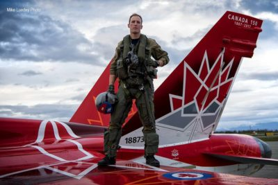 Pilot stands on wing of CF-18 Demo Jet