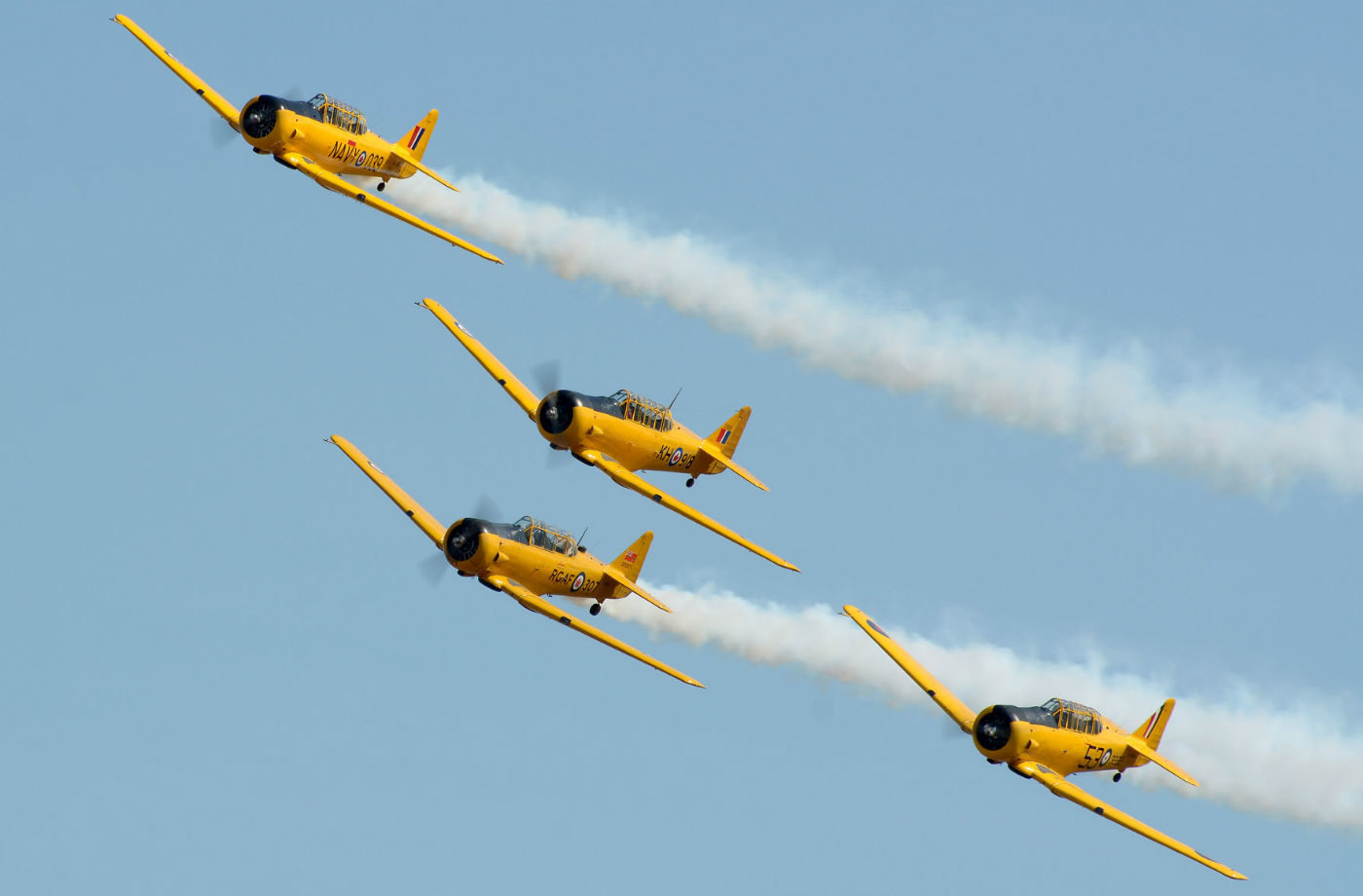Painted yellow in their Royal Canadian Air Force markings, the Harvards never fail to attract attention. Billowing trails of white smoke, the growl of the Pratt and Whitney R-1340 radial engine and a well-choreographed routine have made CHAT a popular airshow act. Eric Dumigan Photo