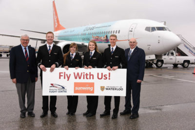 A celebration on the tarmac at the Region of Waterloo International Airport on Feb. 23 included, from left to right, Waterloo Wellington Flight Centre General Manager Bob Connors, newly-minted Sunwing First Officers Cameron Fuchs, Chelsea Anne Edwards, Siobhan O'Hanlon and Spencer Leckie, and Dr. Ian McKenzie, Director of Aviation, Faculties of Science and Environment, University of Waterloo. Mike Reyno Photo